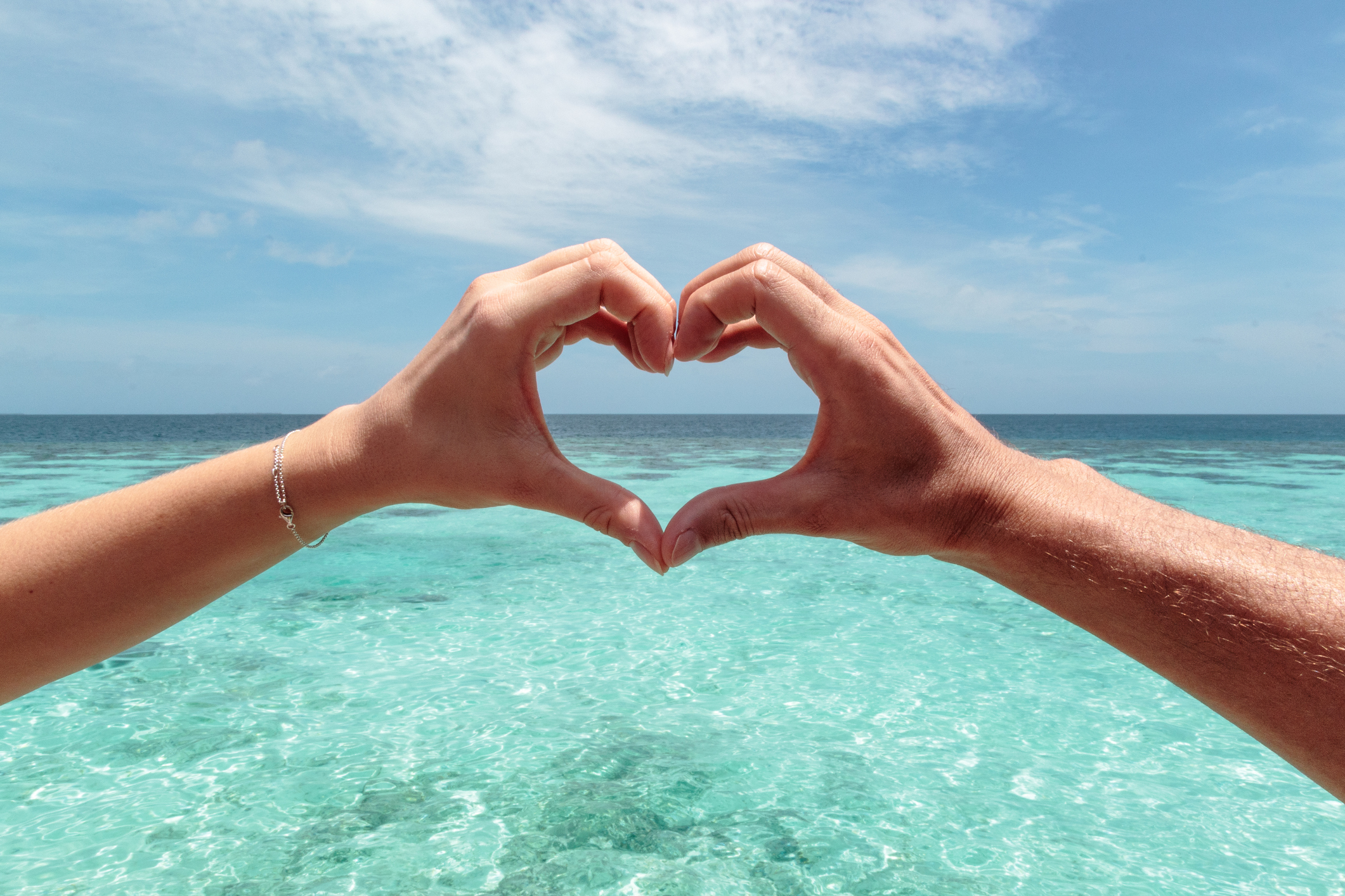 Hand-hearts-blue-water